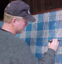 Mike Weaving on a Triangle Loom