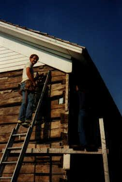 Tim removing siding