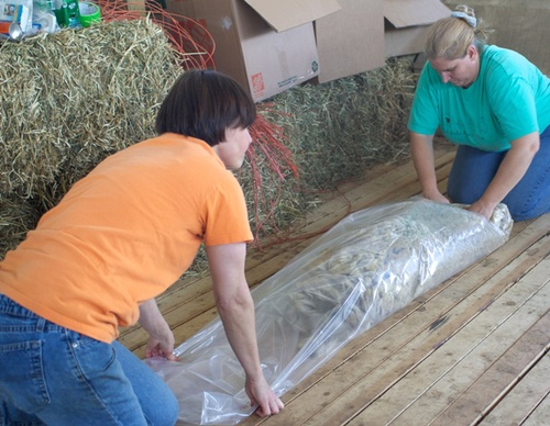 Rolling up a blanket. Also called