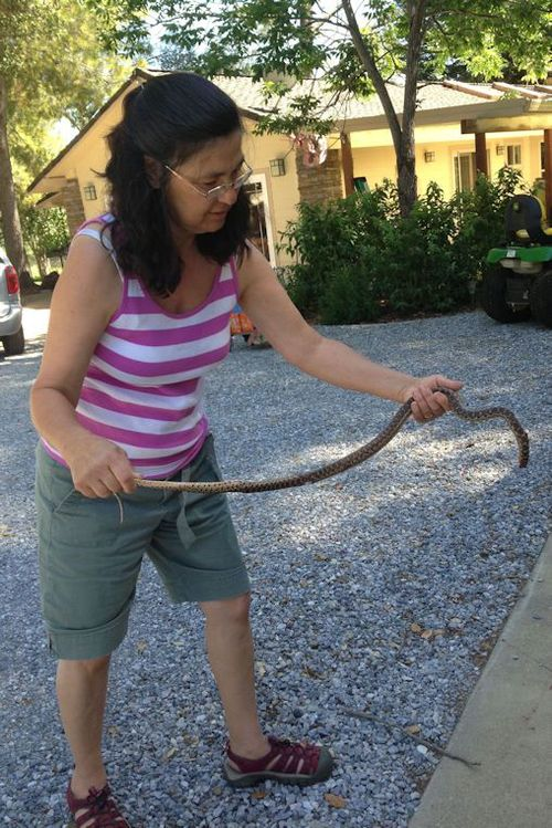 Lin with smaller snake (headless)