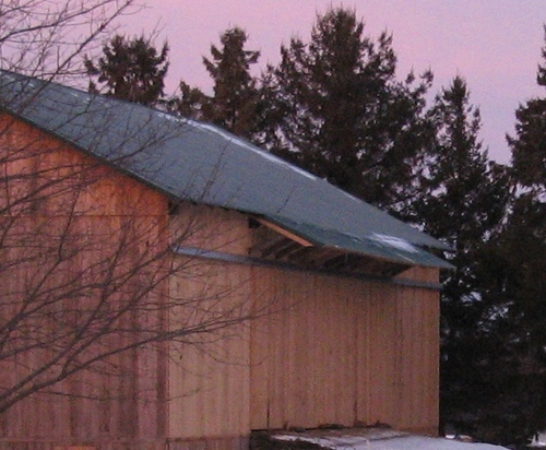 Simple bank barn awning designed to keep rain out of the barn.