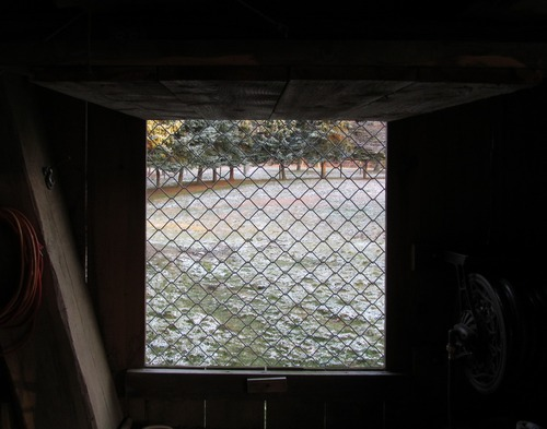 View of barn window opening from the barn interior.