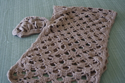 Photo of Hand crocheted matching shawl and cap