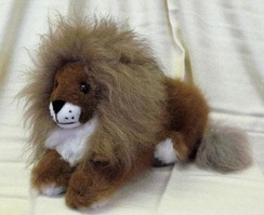 Photo of 100% Alpaca Stuffed Lion Laying