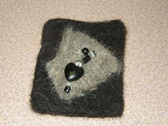 Photo of Pin - black and gray