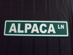Photo of Alpaca Lane Sign