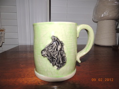 Photo of Stoneware alpaca mug Green and black