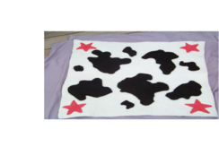 Photo of Cow Print Stroller Blanket