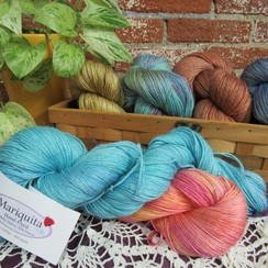 Photo of Mariquita Hand Dyed Yarn - Fingering