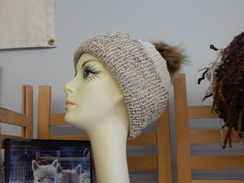 Photo of Knitted hat with fur ball