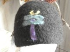 Photo of Felted black alpaca hat with a dragonfly