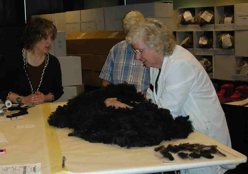 Sara Jane showing fleece features to Marge.