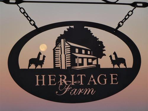 Moon through the farm sign