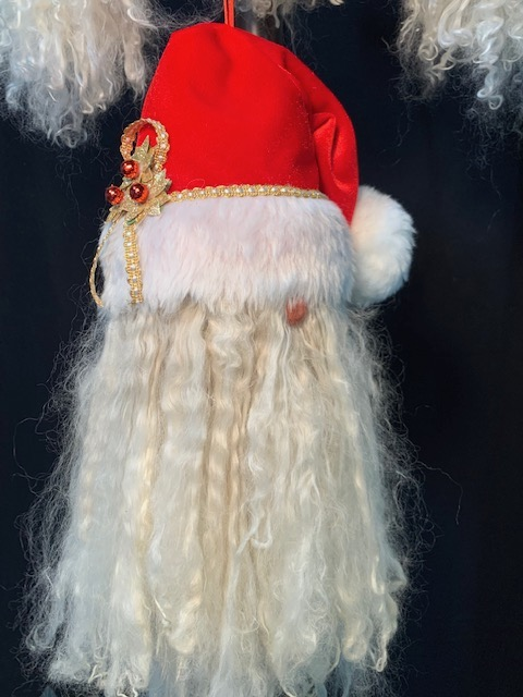 Elegant Suri Santa Ornament.