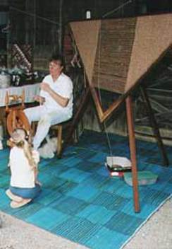 Dianne Demonstrating Spinning & Weaving on a Trangle Loom During an Open House