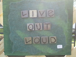 Photo of felted wall hanging - live out loud