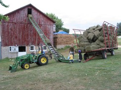 Loading hay into our barn's loft!