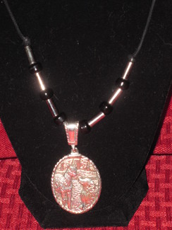 Photo of Sterling paca and Pyr Necklace