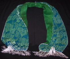 Photo of Green/blue shawl over felted alpaca