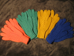Photo of Children's hand knit cable gloves