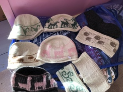 Photo of hand knit hats, headbands or kits