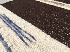 Photo of Brown,white,blue handwoven rug