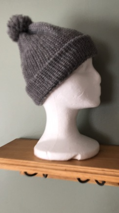 Hand-knit hat with pom-pom