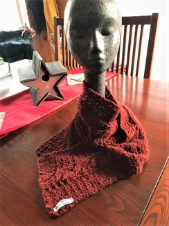 Photo of Brick red cable scarf