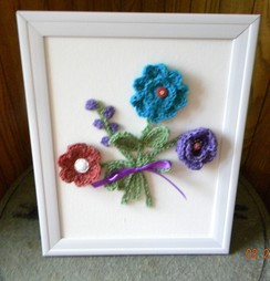 Framed picture of crocheted flowers