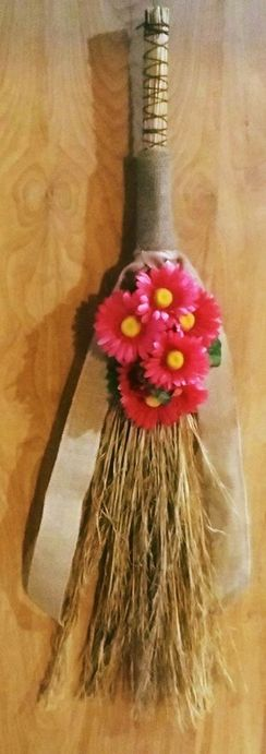 Photo of Decorative Broom with Pink Flowers
