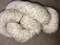 Photo of Yarn- Suri Alpaca- White w/ Red Thread
