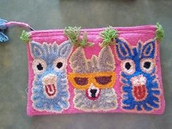 Uniquely embroidered clutch