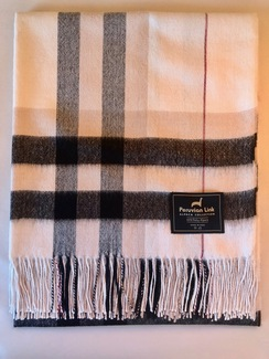 Photo of 100% baby alpaca throw blanket