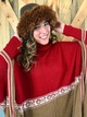 Photo of Alpaca red and tan patterned poncho