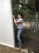 MacKenzie helping build the pig shelter